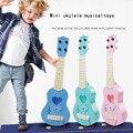 Children's toys 4 cuerdas ukulele guitarra simulación mini en forma de corazón play bebé temprano educativo del instrumento musical toys