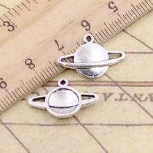 20 pcs Charms saturn planet spark 20x13mm (China)