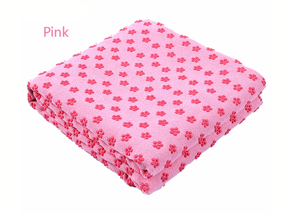 Photo of pink color Yoga mat towel of microfiber & bag. Workout ultrafiber towel mat & mesh bag