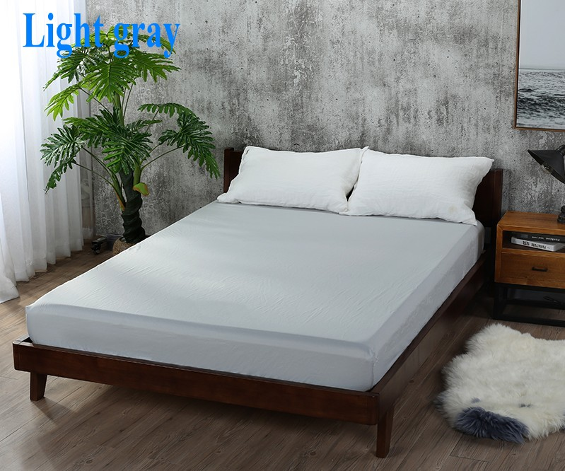 light gray bed sheet