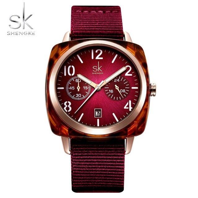 ساعة يد على الموضة من Shengke للنساء مزودة بحزام من النايلون ساعة يد كوارتز للسيدات إصدار جديد 2019