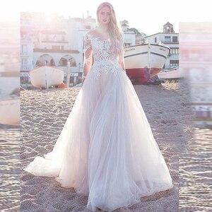Image 1 - 2020 faszinierende Tüll Scoop Ausschnitt EINE Linie Brautkleider Mit Spitze Appliques Langen Ärmeln Strand Hochzeit Braut Kleid