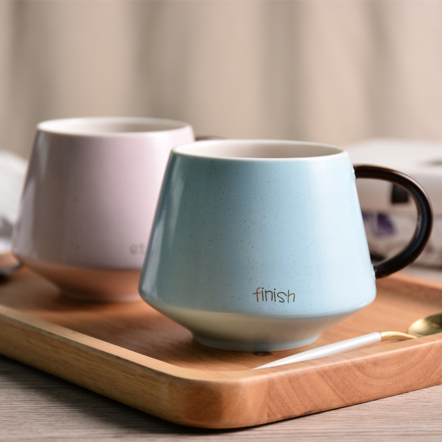 simple and elegant light colored ceramic drinking mugs coffee cups