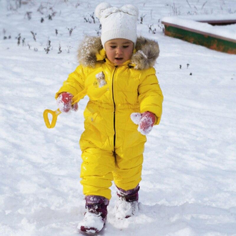Russie hiver enfants filles garçons Snowsuit combinaison bébé blanc canard bas vestes ensemble enfants réel raton laveur à capuche barboteuses Y8