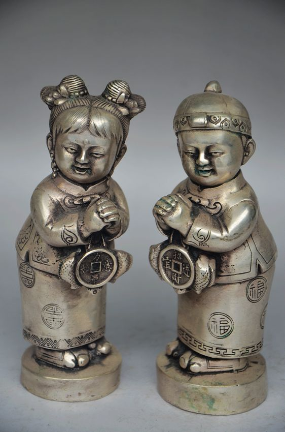 A Pair of Elaborate Chinese Tibetan Silver Handmade Boy and Girl Auspicious StatuesA Pair of Elaborate Chinese Tibetan Silver Handmade Boy and Girl Auspicious Statues