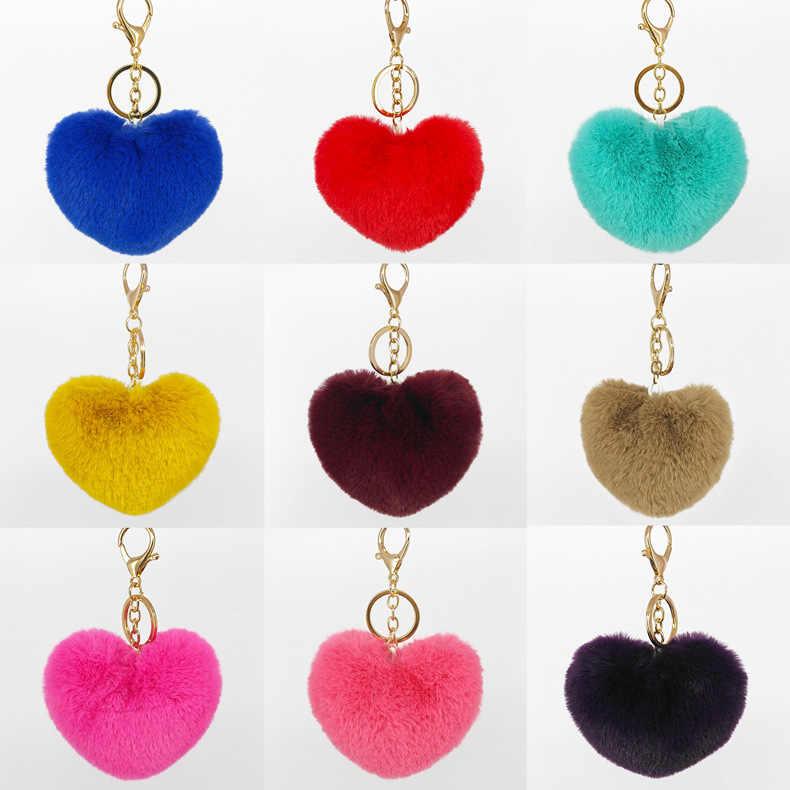 LLavero de piel mullida de lujo suave corazón encantador forma de corazón pompones 8 CM piel de conejo genuino bola coche bolso llavero multicolor