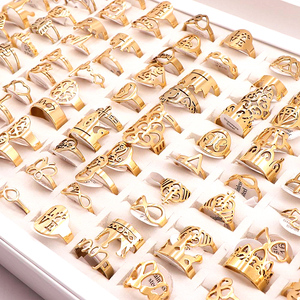 Image 5 - 50Pcs/lot Mix Random Style Laser Cut Pattern Golden Color Stainless Steel Rings Women Party Ring