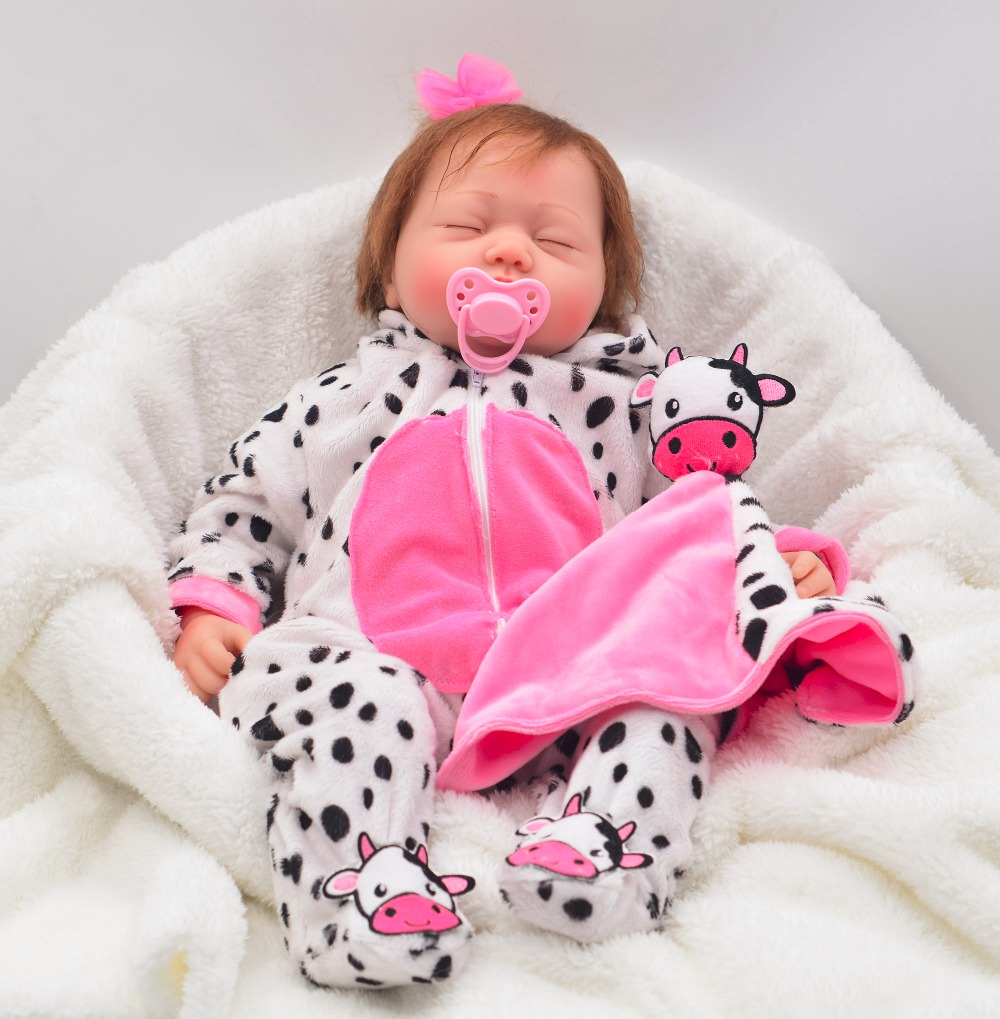 55cm alive Ethnic doll Reborn Baby Dolls Girl Silicone Bebes Reborns Real Reborn Dolls PP filling with Cow clothes unique toy in Dolls from Toys Hobbies