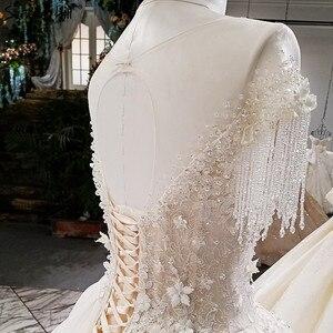 Image 5 - קיצוני יוקרה ללא שרוולים סקסי בציר חתונה שמלות 2020 קריסטל פרחי מותאם אישית high end טול הכלה שמלה