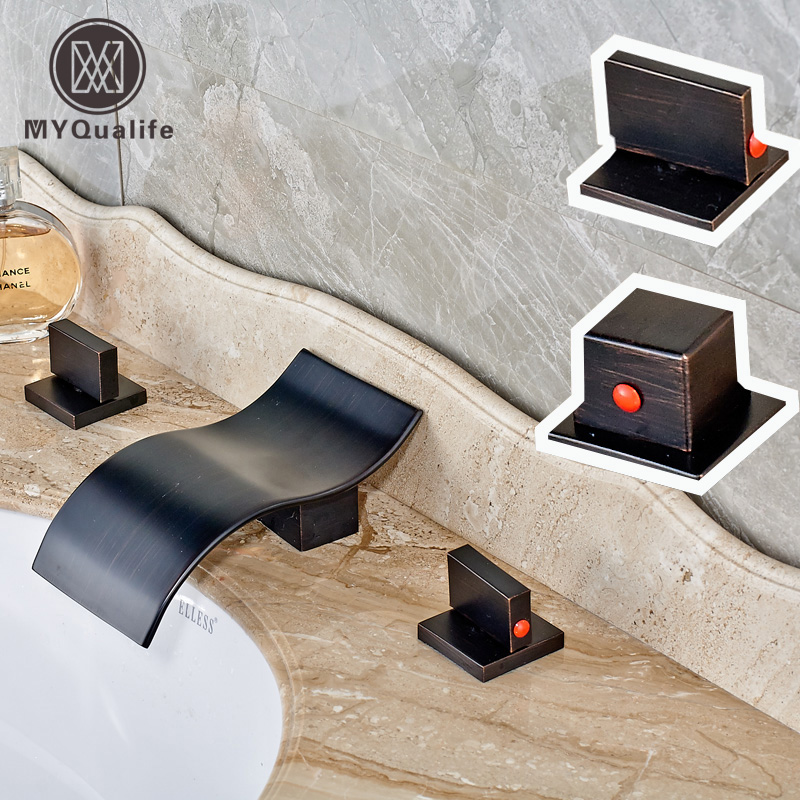 Newly Widespread Deck Mounted Oil Rubbed Bronze Waterfall Basin Faucet 2 Handles 3 Holes Hot and Cold Bathroom Mixer Taps luxury widespread 3 holes basin faucet tap deck mount oil rubbed bronze bathroom mixer taps