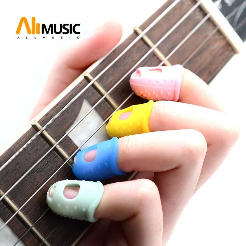 allmusic 4pcs set silicone finger guards guitar fingertip protectors for ukulele guitar s m l. Black Bedroom Furniture Sets. Home Design Ideas