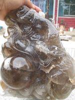 A rare large natural quartz crystal carved dragon totem smoky quartz
