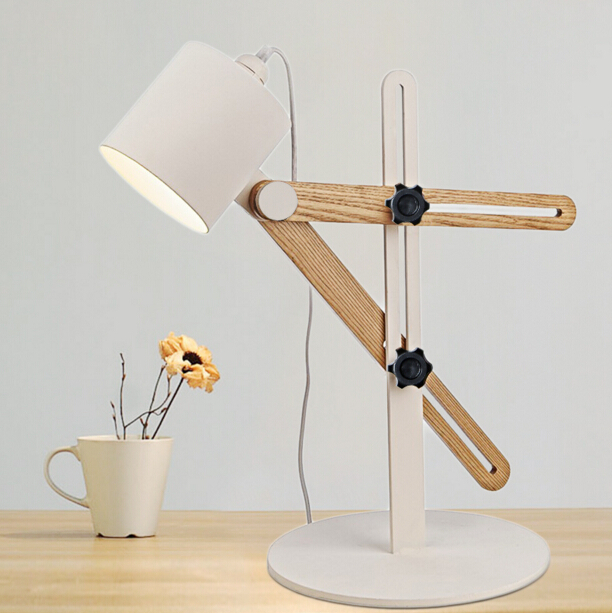 Modern simple bedroom bedside decorative table lamp study nordic art modern simple bedroom bedside decorative table lamp study nordic art creative wooden adjustable table lights free shipping in led table lamps from lights aloadofball Image collections