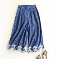 Europa mutanda delle donne Degli Stati Uniti commercio all'ingrosso 2018 di estate nuovo semi-elastico in vita pantaloni larghi del piedino ricamato Tencel dei jeans pantaloni