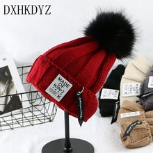 DXHKDYZ Autumn and winter women 's hat imitation cashmere sweater hat knitted hat paternity fashion iron ring pendant cap