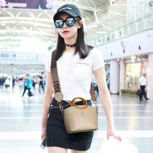 Image 2 - Брендовая женская сумка JIANXIU из искусственной кожи, круглая портативная дизайнерская сумка тоут, 2019, женские сумки мессенджеры на плечо, двойные Наплечные ремни