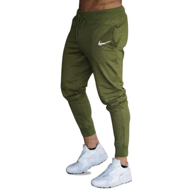 2018 New Men Joggers Brand Male Trousers Casual Pants Sweatpants Men Gym Muscle Cotton Fitness Workout hip hop Elastic Pants
