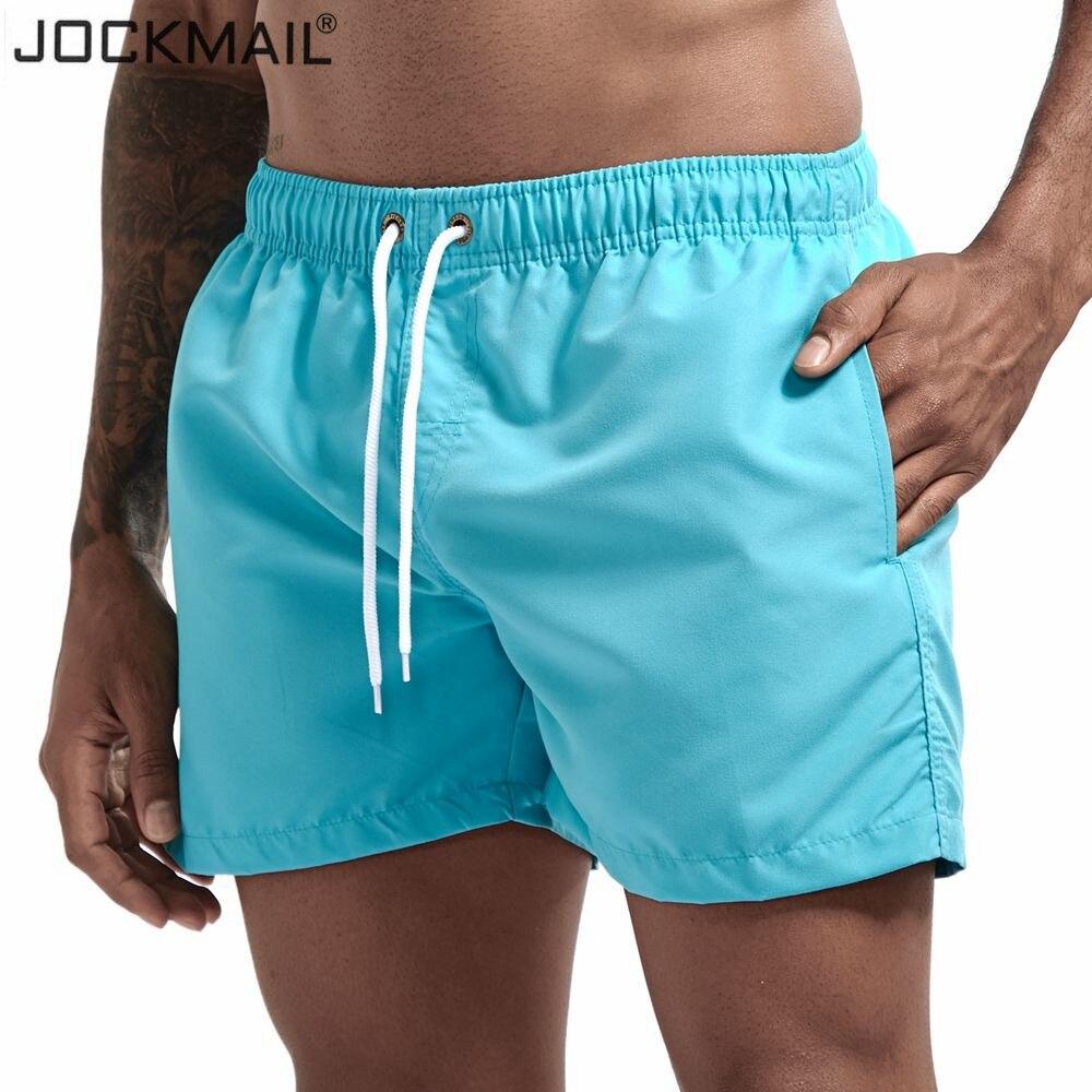 JOCKMAIL Men's Board Shorts Fast Dry 2020 Summer Holiday Beach Surf Pocket Swimming Trunks Sport Running Hybird Shorts
