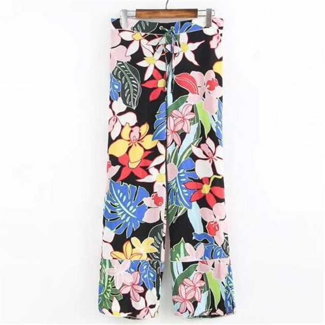 181dd227a6 Estampado de flores de colores pantalones anchos de la pierna pantalones de  las mujeres elegantes otoño