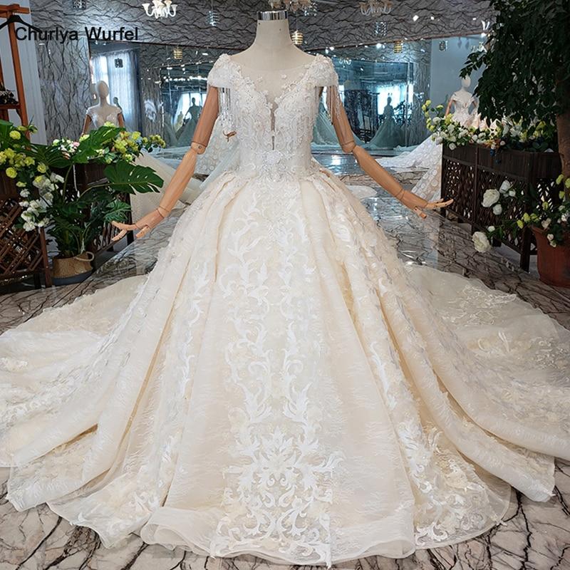 Femmes de luxe deded robe gland cristal cap manches princesse robe de mariée long train anniversaire discount Suknia slubna LS00380