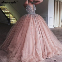 Champagne Tulle Ball Gown Quinceanera Dress 2019 Elegant Heavy Beaded Crystal Deep V Neck Sweet 16 Dresses Prom Gowns