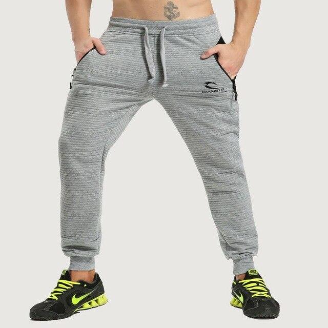 Marca 2018 nueva medalla de oro Fitness Casual pantalones elásticos de algodón elástico XZ8