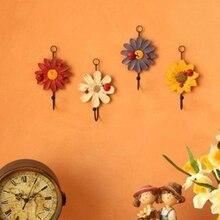 Hot sale painted flower resin wrought iron hook garden wall hanging door back coat
