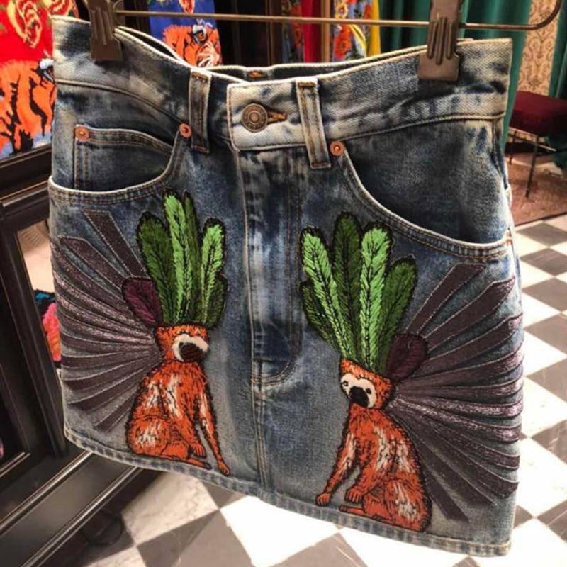 2018 printemps été piste taille haute Denim jupe femmes décontracté singe broderie une ligne Mini jupe paquet bleu tout assorti Jeans
