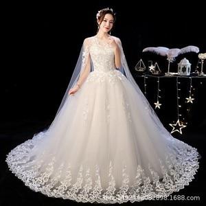 Image 1 - Robe de mariee lindo vestidos de casamento vestido de baile o pescoço rendas acima com apliques jaqueta mariage vestidos de noiva casamento 2020