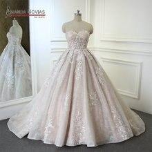 Свадебное платье без бретелек цвета шампанского, а силуэта от Amanda Novias