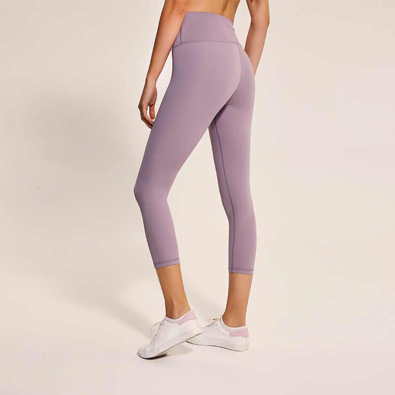 d661127ab1 ... Eshtanga Yoga crop high waist Women Sports leggings Solid Elastic Waist  Yoga pants Cross Design hollow ...