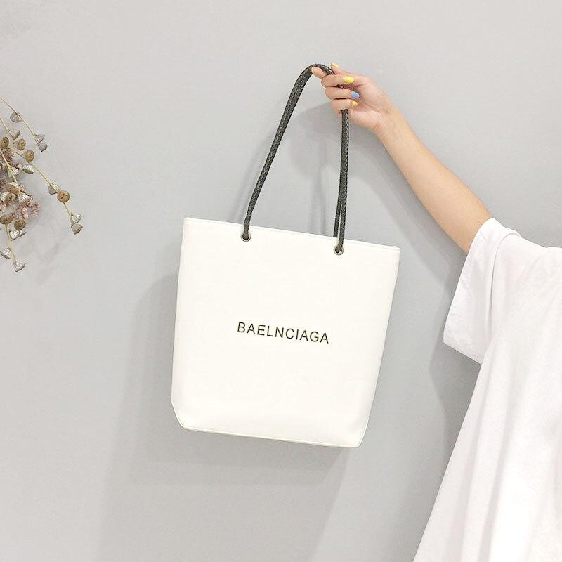 Bolsos de lujo de mujer bolsos de diseñador nuevo estilo Casual bolsos de hombro Unisex PU de alta capacidad bolso de mano de mujer