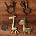 10 Unids/lote Lindo Plateado Bronce Antiguo del Metal Caballo Jirafa Llavero Animal de la Cadena Dominante del Anillo Dominante Del Coche
