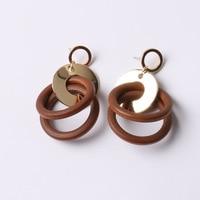 2017 New Korean Metal Geometric Hollow Wood Ring Earrings Female Temperament Fight Color Discs Baroque Earrings