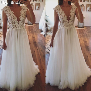 Image 1 - تغرق الرقبة الدانتيل فستان الزفاف خط الوهم الخلفي الاستقبال فستان زفاف 2020