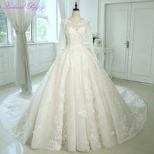 Efektowne damskie koronkowe aplikacje suknie ślubne linii 2020 długie rękawy z wycięciem suknie ślubne Vestido de Novia z kwiatami