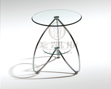 Toughened glass small tea table.. Sofa. Round side tables.