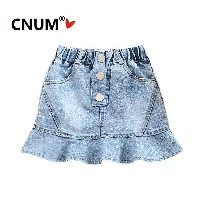 3404448ce Falda corta con botones de Jean para niñas CNUM estilo sirena ropa moda  2019 verano diseño caliente pequeñas