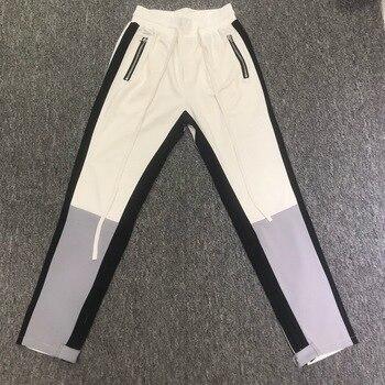2018fw Fear Of God Fifth colección color bloqueo rayado hombres Jogger  pantalones Hiphop Streetwear hombres Track pantalones Joggers a9476aadd500