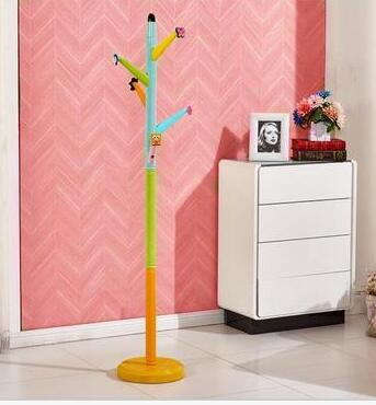 Childrens clothes tree. Cartoon hangers. Study bedroom ground hanging clothes