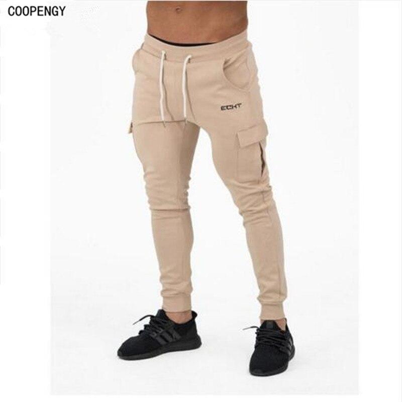 2017 nueva marca de moda para hombre joggers pantalones slim fit de los hombres hoody ocasional activo pantalones deportivos Env