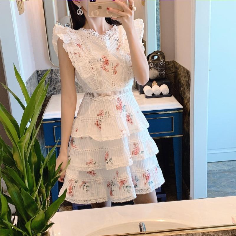 Imprimé dentelle lotus feuille gâteau robe 2019 printemps et été nouveau femmes broderie papillon manches dentelle mini robe à volants