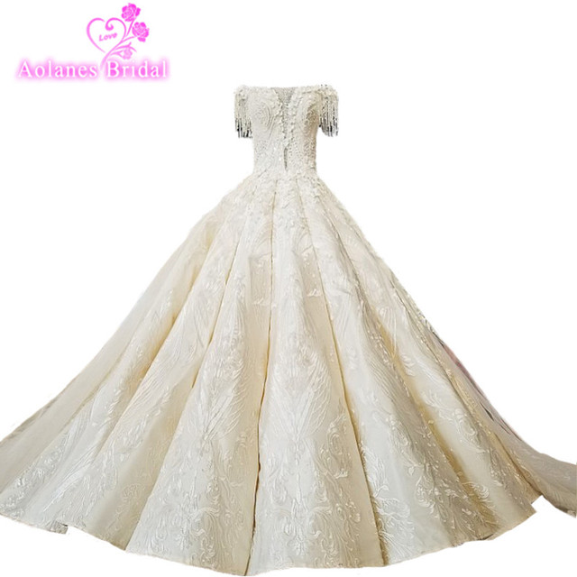 d4a0695be6 AOLANES 2018 Champagne Lace Sleeveless Bridal Gowns Long Train Lace Up Ball  Gown Vintage Wedding Dresses Vestido De Noiva