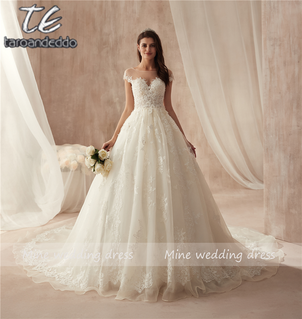 Us 136 4 12 Off Vintage Turkey Lace Ball Gown Wedding Dress 2019 Off Shoulder Princess Lebanon Illusion Jewel Neck Arab Bride Bridal Dress Gown In