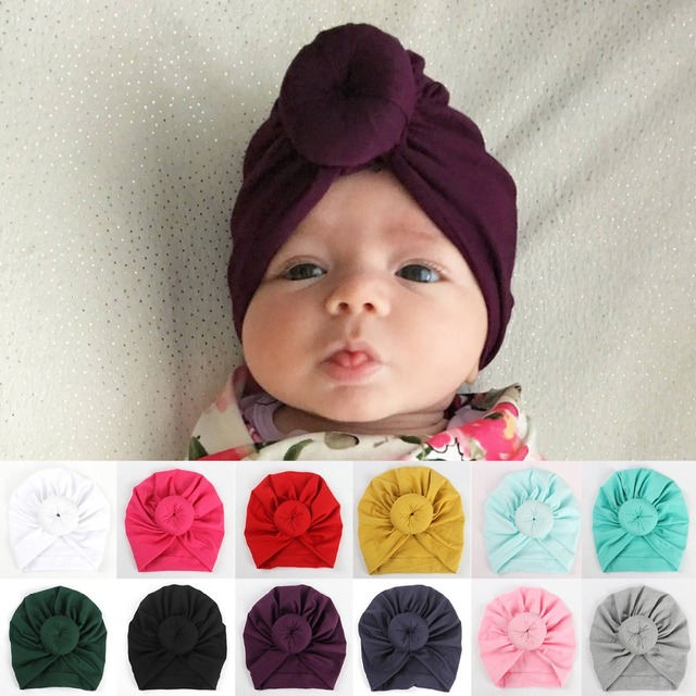 New Baby girls Solid Color Donut Hats BeBek Turban Hood Solid Knotted Cap  Unisex Cotton Soft d86d90c47e97