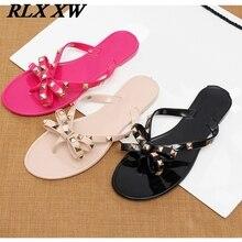 b7ff83d053d63 2019 fashion women sandals flat jelly shoes bow V flip flops stud beach shoes  summer rivets
