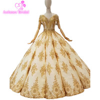 2018 Dubai Arabic Gold Lace V neck Long Sleeves Floor length Bridal Gowns Backless Waves Ball Gown Vintage Wedding Dresses Real