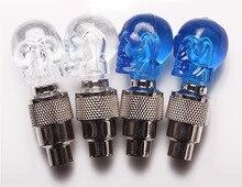 купить Skull Bicycle Valve stem LED Motion Activated Light Safety Cycling Lamp Wheel Tire Valve Caps Fashion Bike Accessories недорого