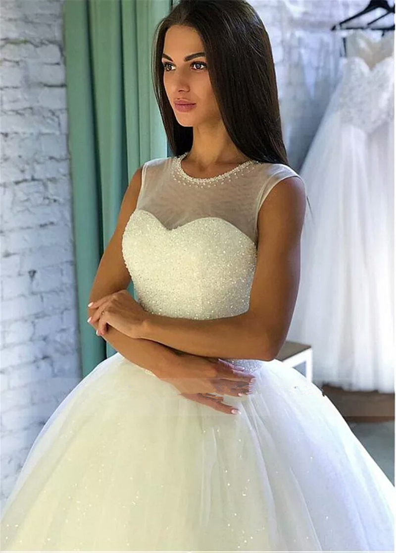 Crystal Beaded Floor Length White Ball Gown Wedding Dress Sheer Neck Sleeveless Tulle Sequins Wedding Gown Gelinlik in Wedding Dresses from Weddings Events
