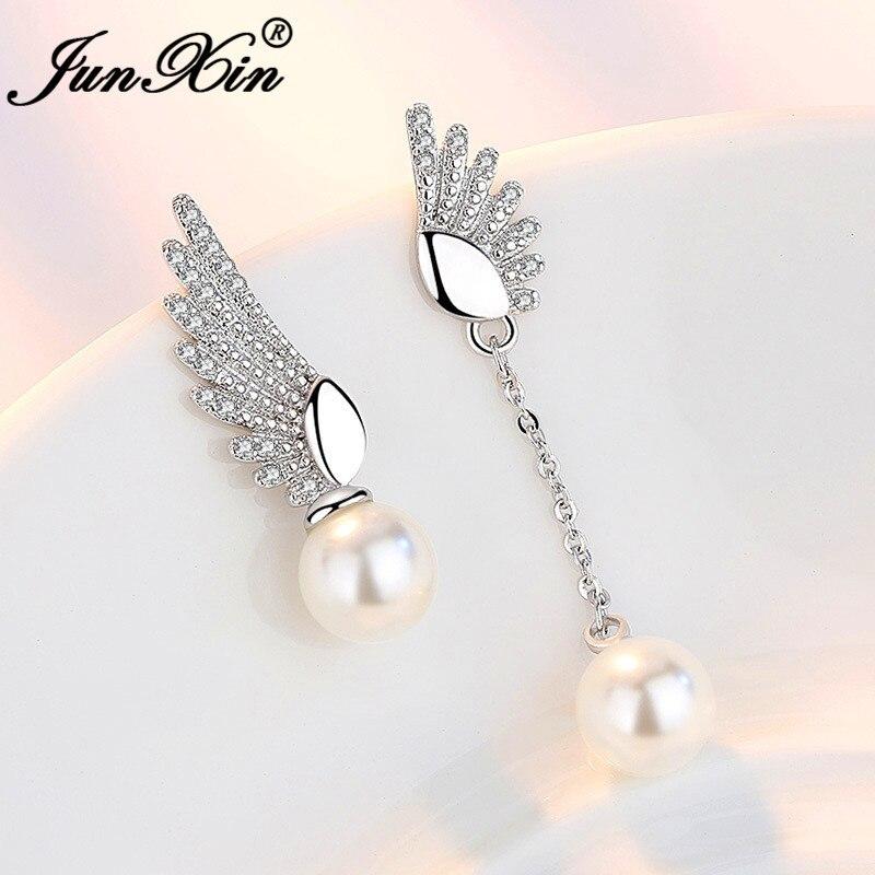 JUNXIN Cute Asymmetry Angel Wings Stud Earrings For Women Silver Color Small White Crystal Stone Wedding Beads Pearl Earrings CZ